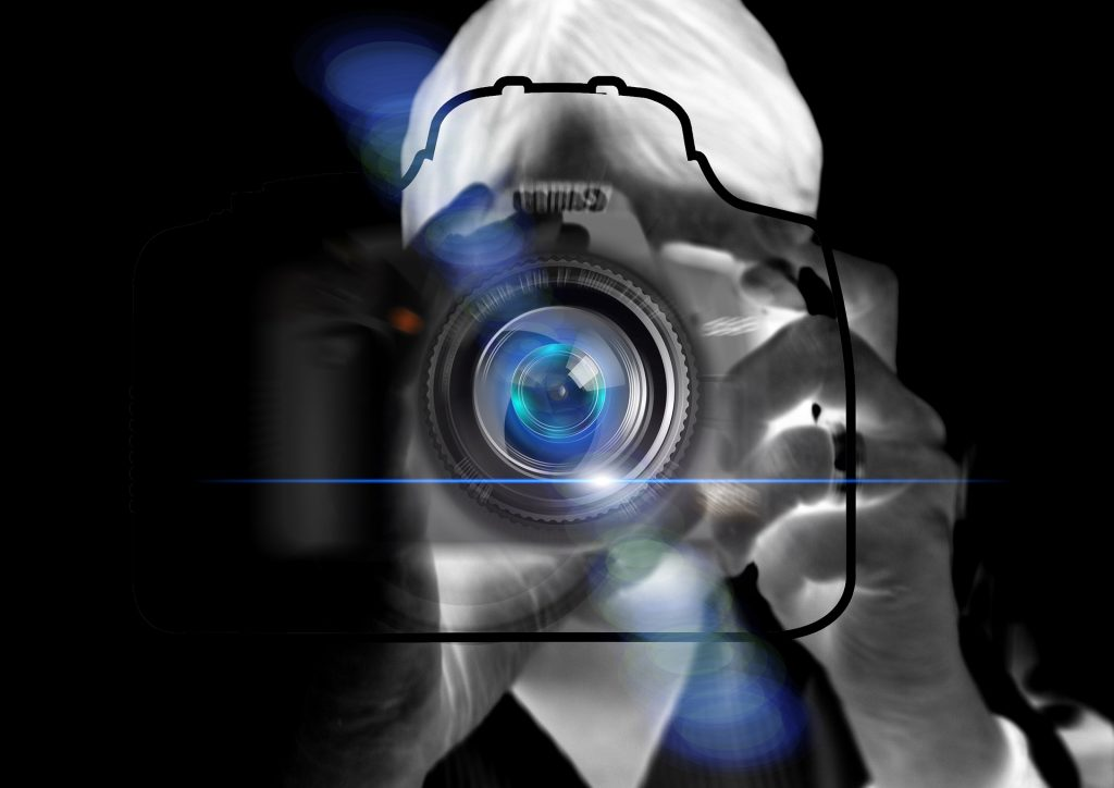 Abstract image of camera with photographer in negative