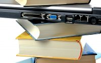 Stack of books with laptop wedged in between