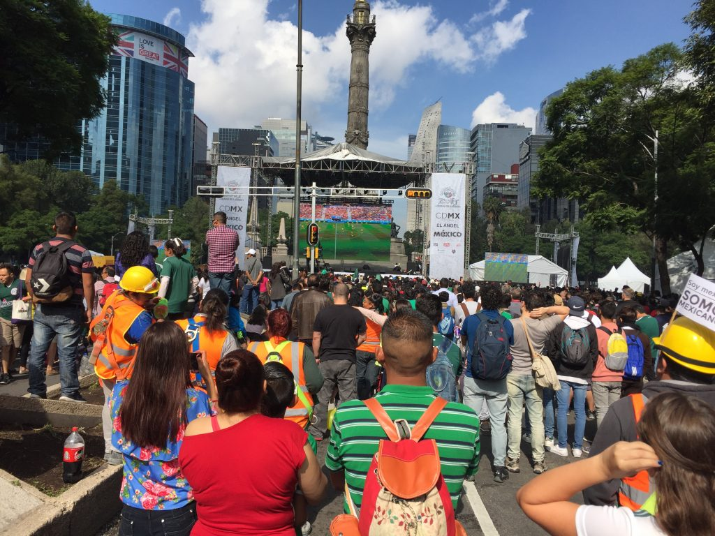 Futbol fans watch a giant screen in the Plaza del Ángel in Mexico City.