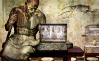 Human statue and laptop.