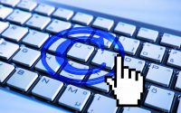 Copyright symbol projected on keyboard with digitized clicking finger