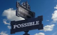 """Street signs marking intersection of """"possible"""" and """"impossible."""""""