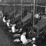 Black workers operating linotype machines