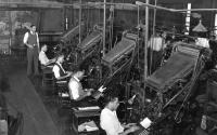 Black workers operating linotype machines
