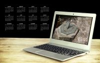 image of sun dial on laptop screen with 2019 calendar in background